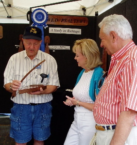 A. Smith with dulcimer at art fair